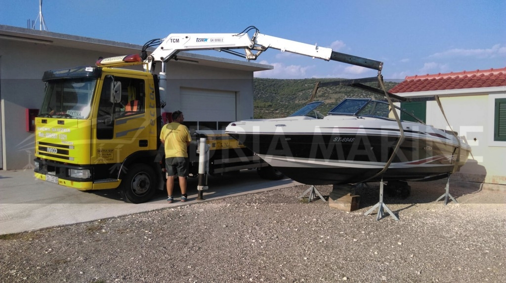 Unload speedboat to dry dock storage facility